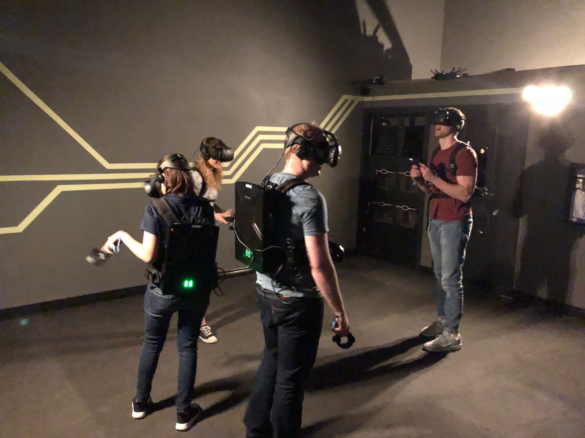 VR escape room players wearing equipment